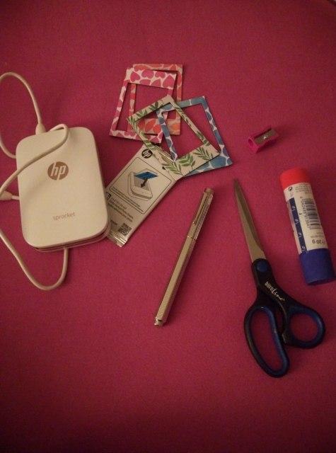 Gadgets: HP sprocket, ZINK photo paper, polaroid picture frames, Caran d' Ache pen, scissors, glue, pencil sharpener